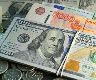 Рубль снижается к доллару на фоне ухудшения аппетита к риску